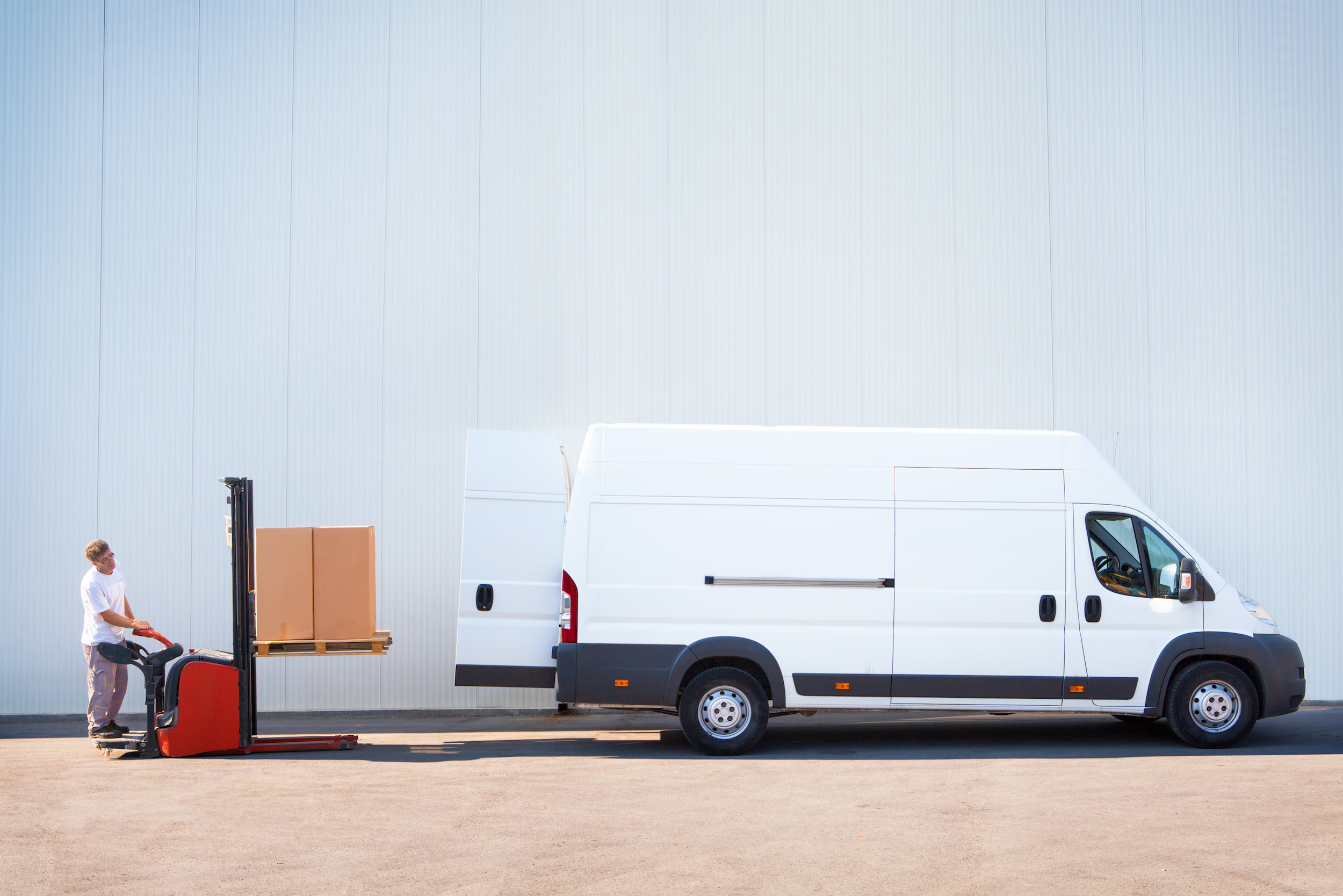 Courier is loading the van with parcels